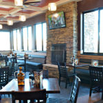 Dining room with fire place inside of Granite City Food and Brewery